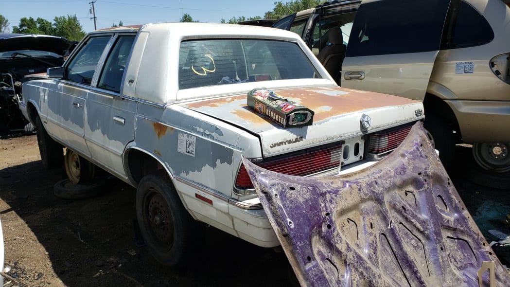 38 - 1988 Chrysler LeBaron in Colorado junkyard - photo by Murilee Martin