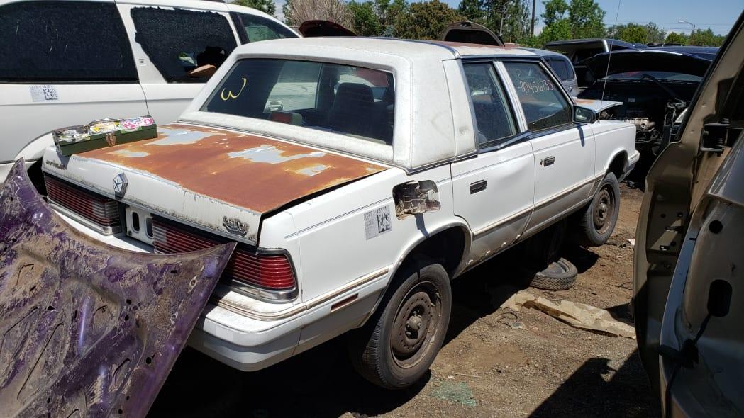 42 - 1988 Chrysler LeBaron in Colorado junkyard - photo by Murilee Martin