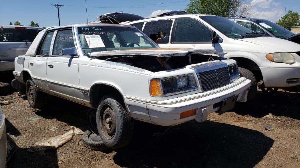46 - 1988 Chrysler LeBaron in Colorado junkyard - photo by Murilee Martin