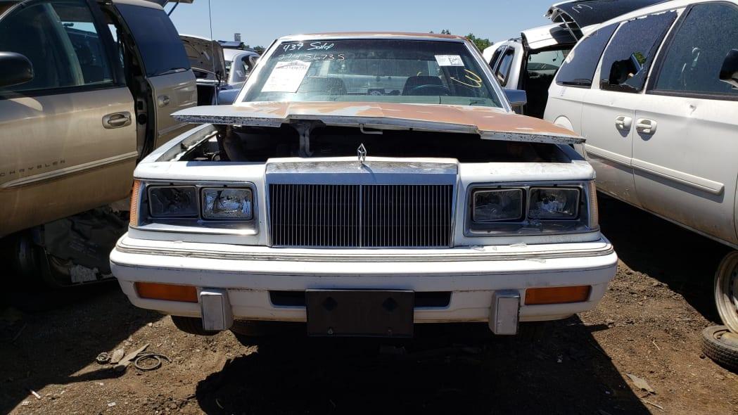 50 - 1988 Chrysler LeBaron in Colorado junkyard - photo by Murilee Martin