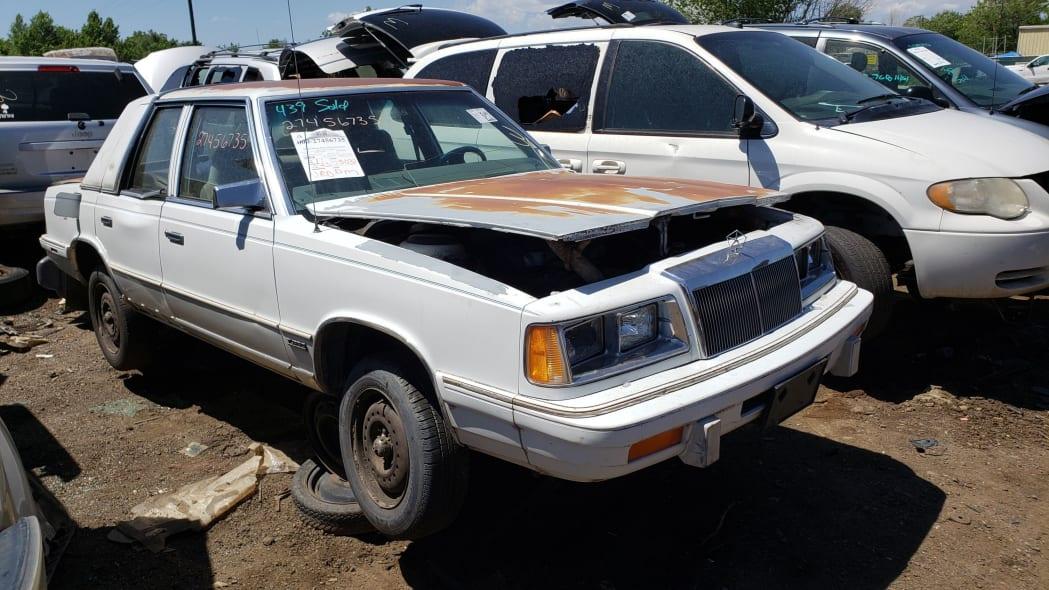 99 - 1988 Chrysler LeBaron in Colorado junkyard - photo by Murilee Martin