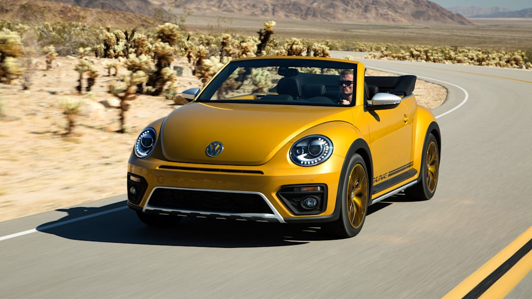 vw beetle dune convertible on the road