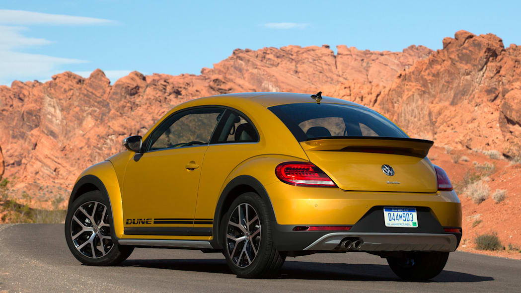 vw beetle dune coupe rear three quarters in desert