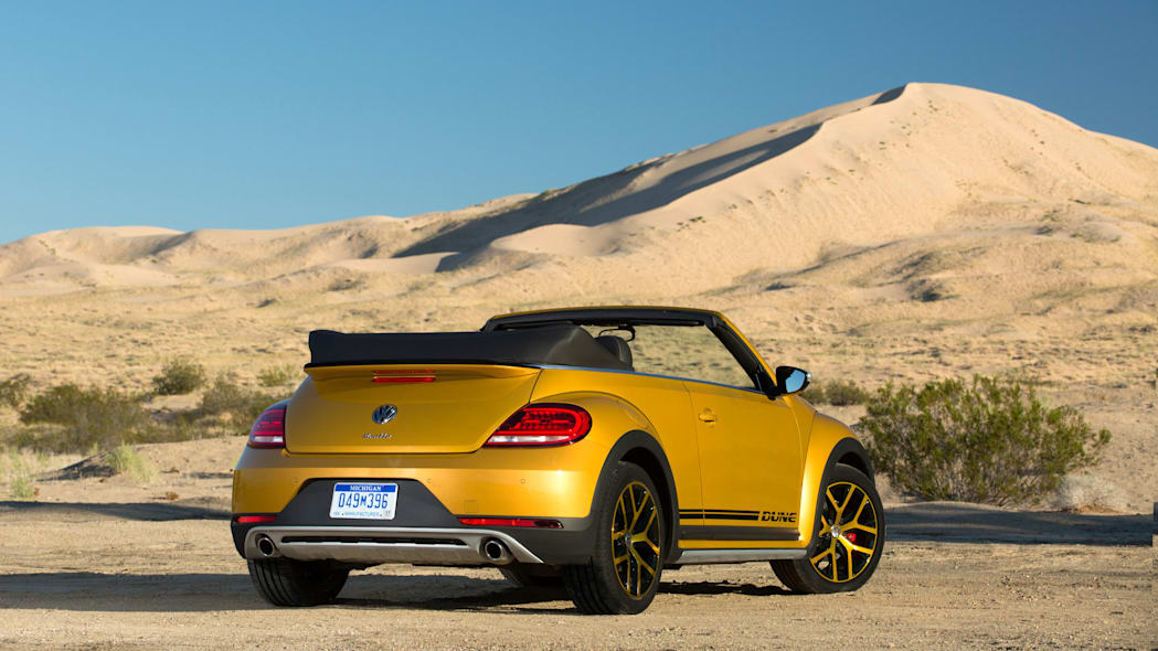 vw beetle dune convertible rear three quarters in desert
