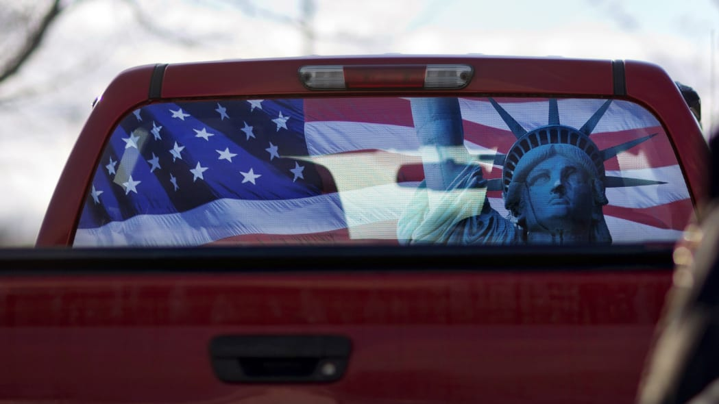 Pickup truck with flag rear window
