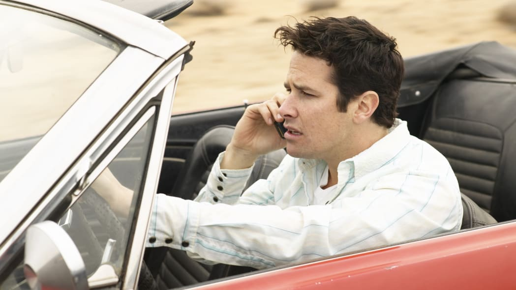 Man driving and talking on cell phone