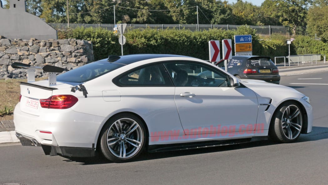 BMW M4 With Extreme Aero Spy Shots Side Rear Exterior