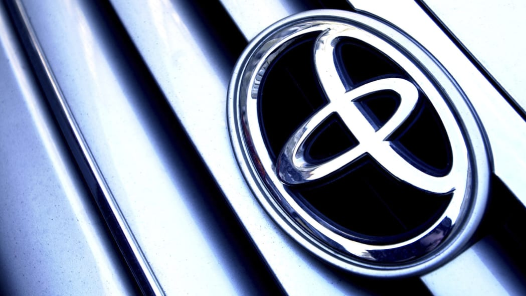 Picture shows a Toyota car emblem on a vehicle in Central London.