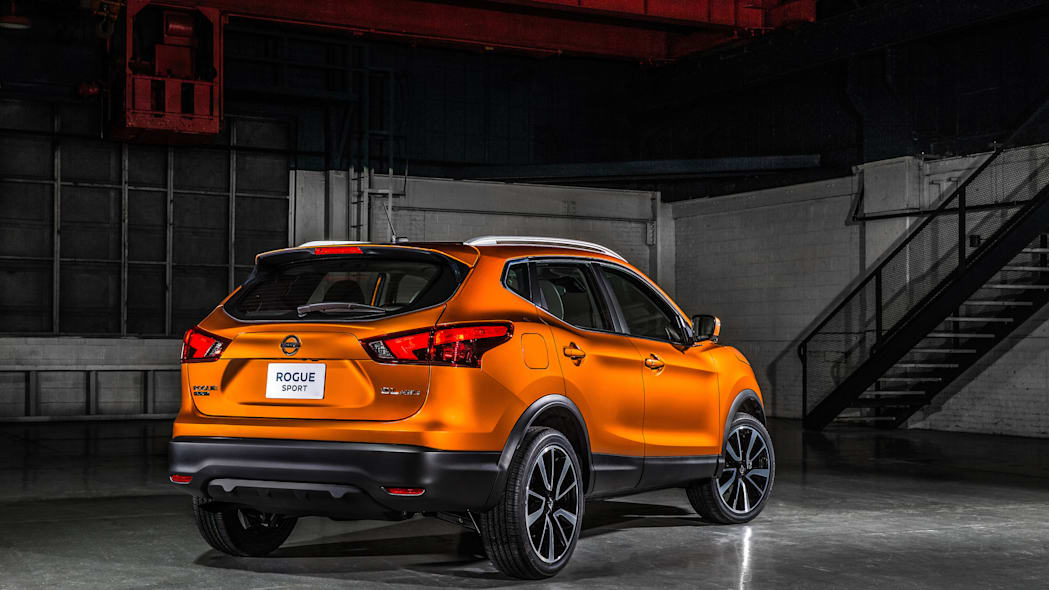 The 2017 Nissan Rogue, unveiled at the 2017 Detroit Auto Show, rear three-quarter view.