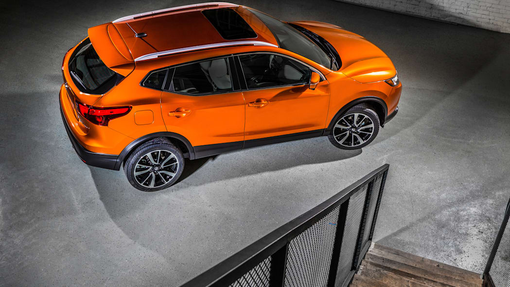 The 2017 Nissan Rogue, unveiled at the 2017 Detroit Auto Show, overhead rear three-quarter view.