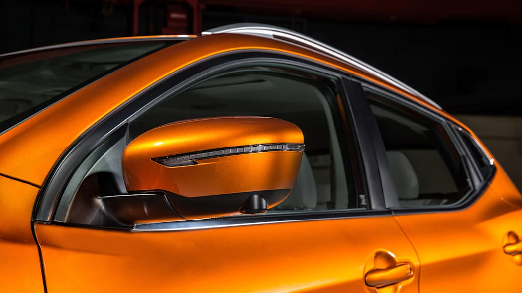 The 2017 Nissan Rogue, unveiled at the 2017 Detroit Auto Show, side mirror highlight.