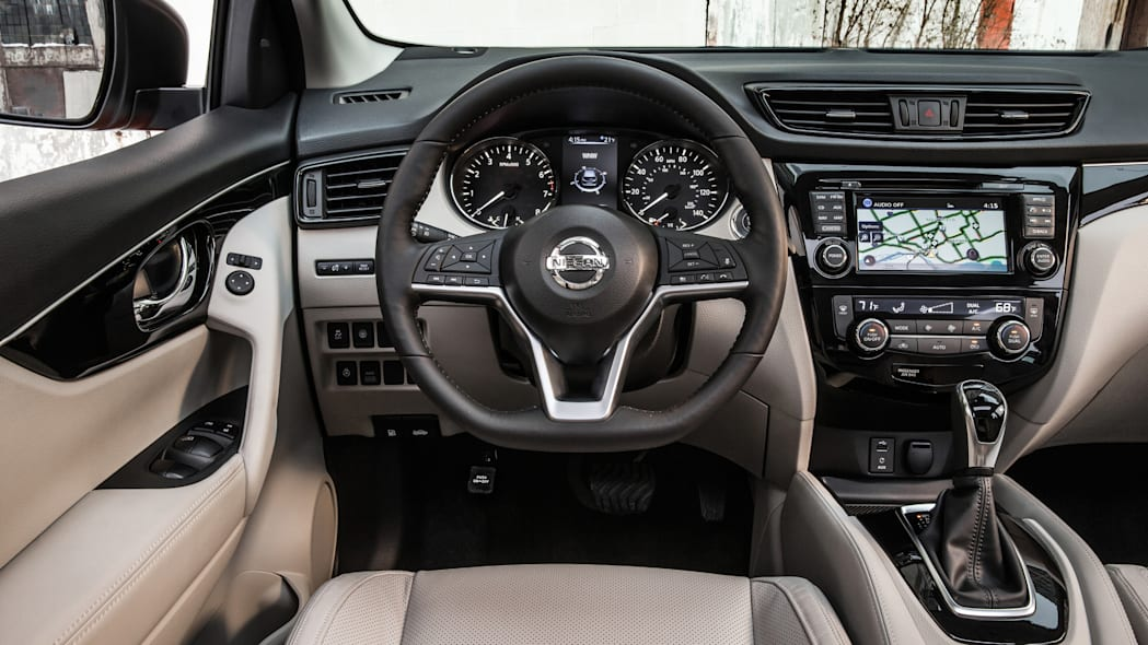 The 2017 Nissan Rogue, unveiled at the 2017 Detroit Auto Show, dashboard, steering wheel, and instrument panel.