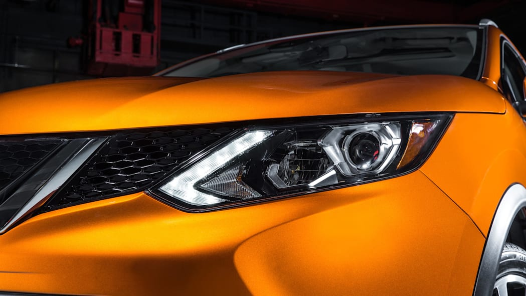 The 2017 Nissan Rogue, unveiled at the 2017 Detroit Auto Show, headlight detail.