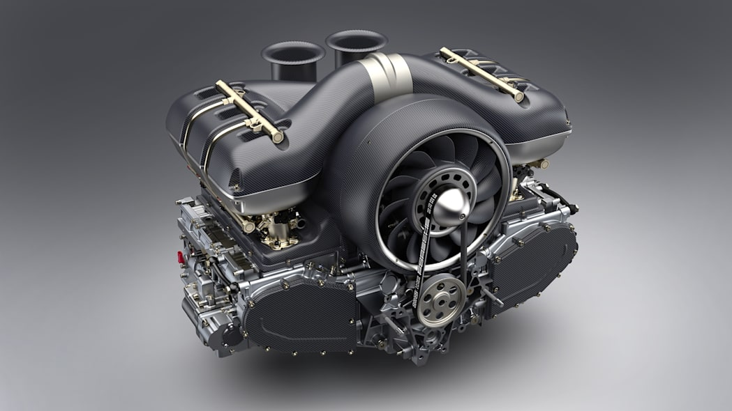 Porsche 4.0L air-cooled flat-six with 4-valve cylinder heads, showing carbon fiber airbox, fan shroud and intake trumpets with CFD-optimized and enlarged fan. Restored and modified by Singer Vehicle Design and Williams Advanced Engineering.