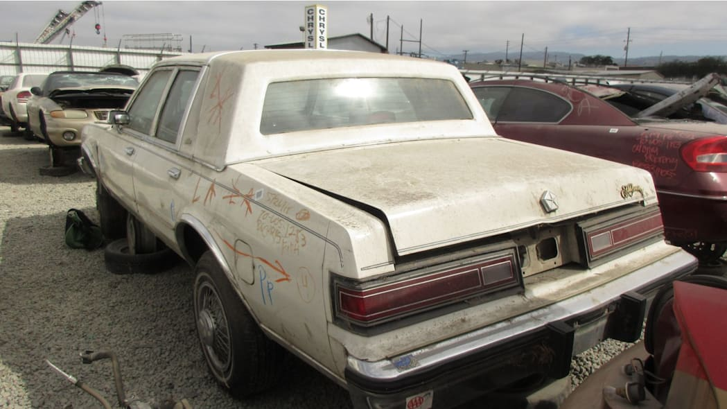 1986 Chrysler Fifth Avenue in California wrecking yard