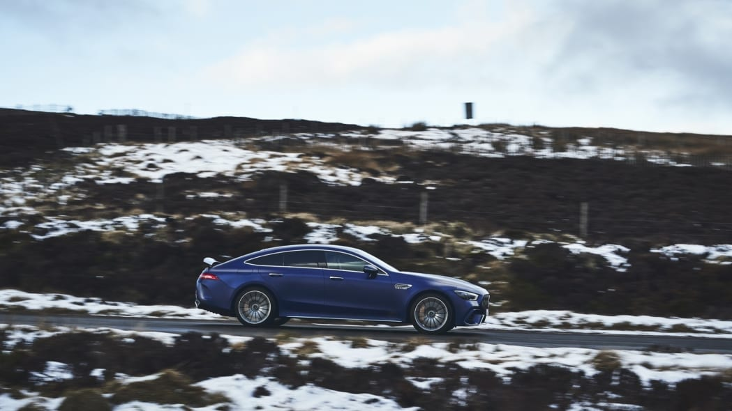 2020 Mercedes-AMG GT 63 S Sedan side blue snow road driving