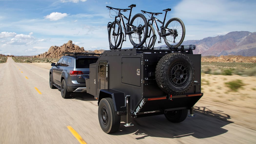 VW Atlas Basecamp In motion with the Hive Ex Trailer behind