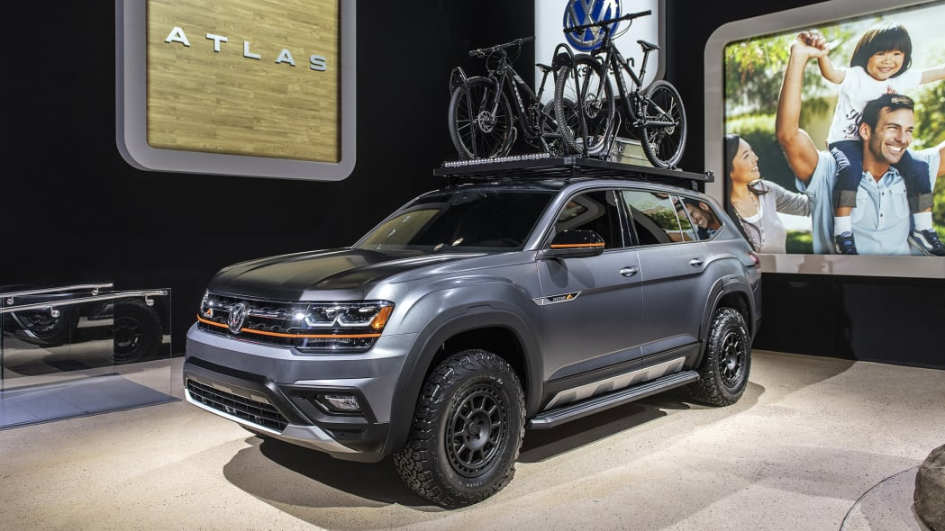 The Atlas in a show room, boasting a sturdy roof rack with two bikes attatched
