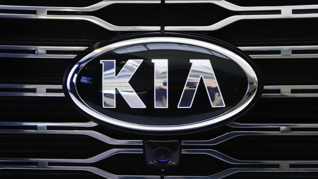 Kia logo on a vehicle grille