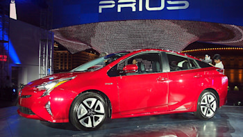 2016 Toyota Prius Red At Reveal Event Front Side Profilt