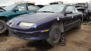 junkyard gem 1996 saturn sc1 with innovative custom interior autoblog junkyard gem 1996 saturn sc1 with
