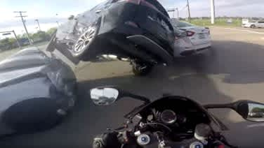 Motorcyclist survives close call in car crash caught on