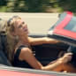 infiniti vacation ad with woman in lamborghini