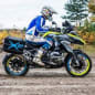 The two-wheel drive Wunderlich BMW R1200 GS LC, which uses a 10kW hub motor up front and a battery pack under the beak, dynamic side view.