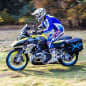 The two-wheel drive Wunderlich BMW R1200 GS LC, which uses a 10kW hub motor up front and a battery pack under the beak, going downhill.