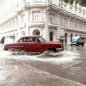 carros de cuba car splashing through waer