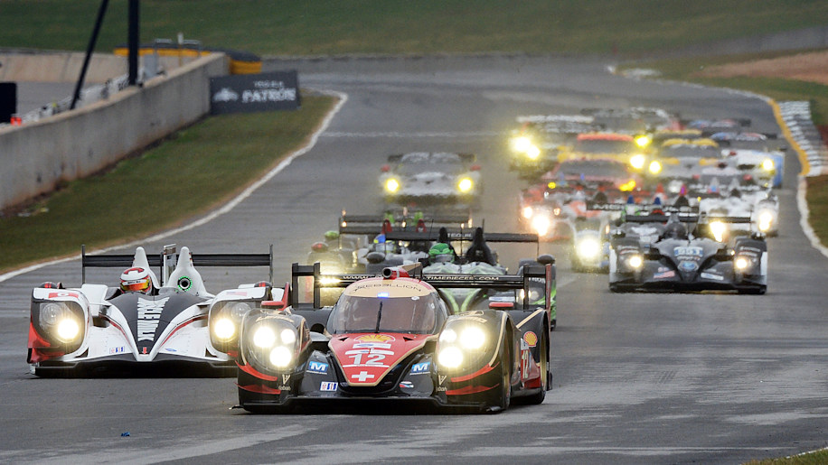 Petit Le Mans Auto Racing (Neel Jani (12), of Switzerland, drives the Rebellion Racing Lola B12/60 Toyota at the start of the American Le Mans Series' Petit Le Mans auto race at Road Atlanta, Saturday