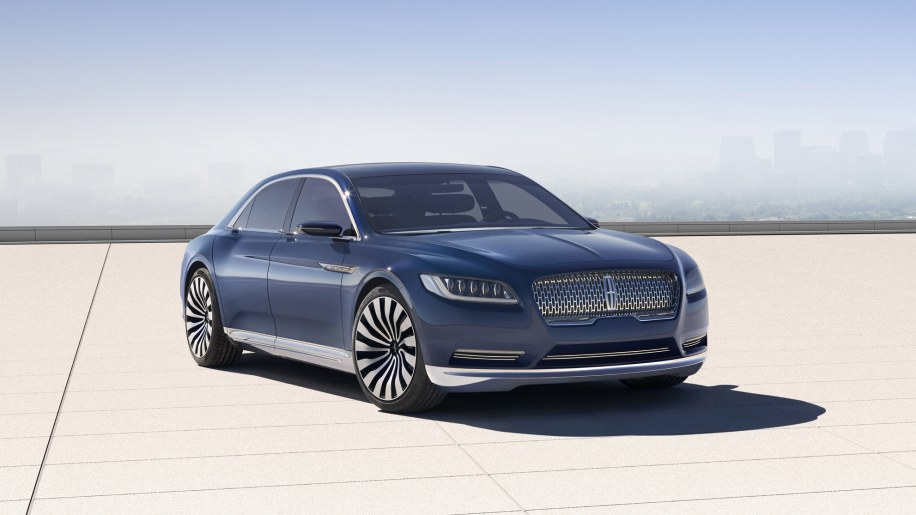 Lincoln Continental Concept in blue with city skyline