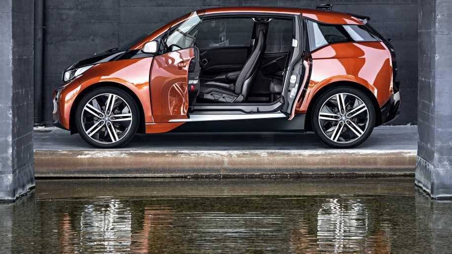 BMW i3 hatchback in orange with its reflection in water