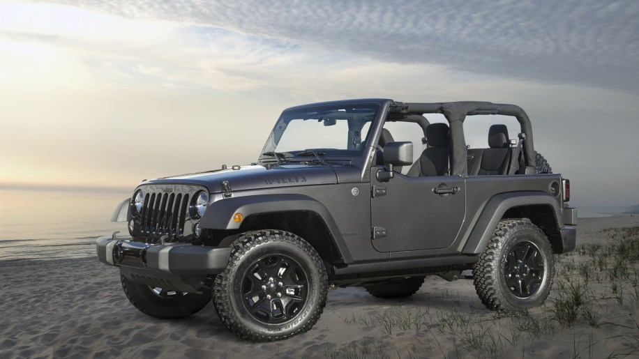 2015 Jeep Wrangler in dark grey on the beach