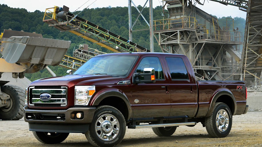 2015 Ford Super Duty in deep red on a job site