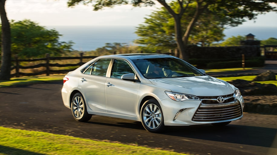2015 Toyota Camry in silver on a winding road