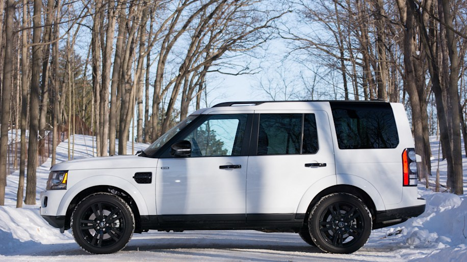 Land Rover LR4 white profile winter woods