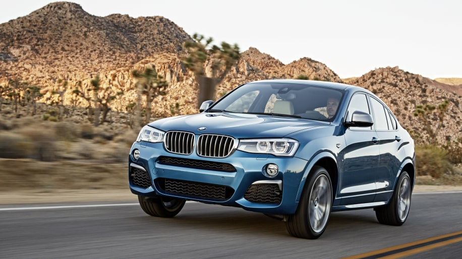 BMW X4 M40i front 3/4 driving road