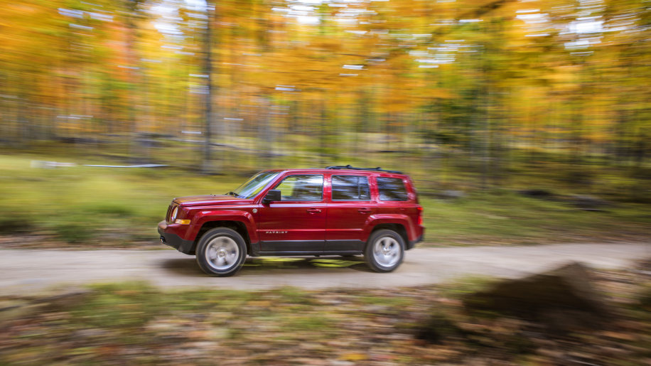 2014 Jeep Patriot red driving forest