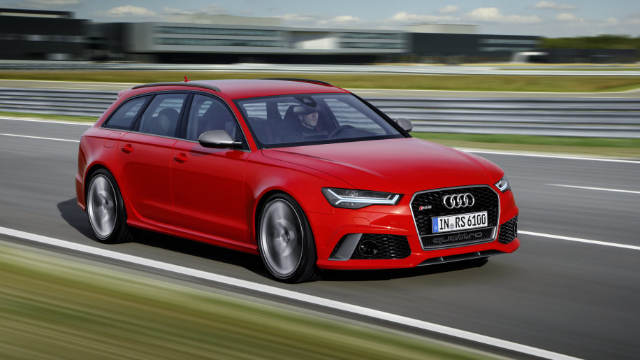 red audi rs6 avant performance front three quarters road