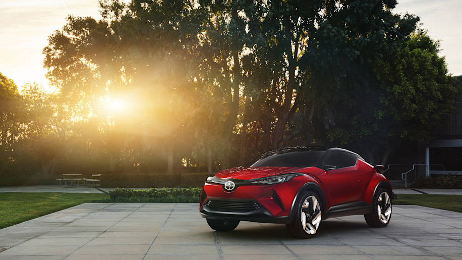 The Scion C-HR concept shown off in red for the LA Auto Show, front three-quarter view.