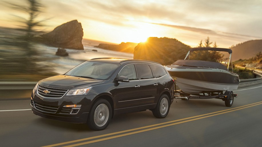 Chevy Traverse in black towing a boat