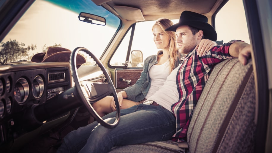 Caucasian couple relaxing in truck