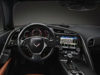 2019 chevrolet corvette vs 2019 nissan 370z and 2019 porsche 911 interior photos