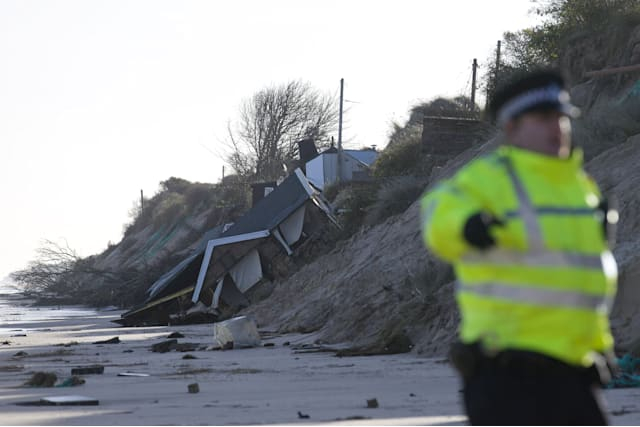 Village devastated as homes fall into the sea