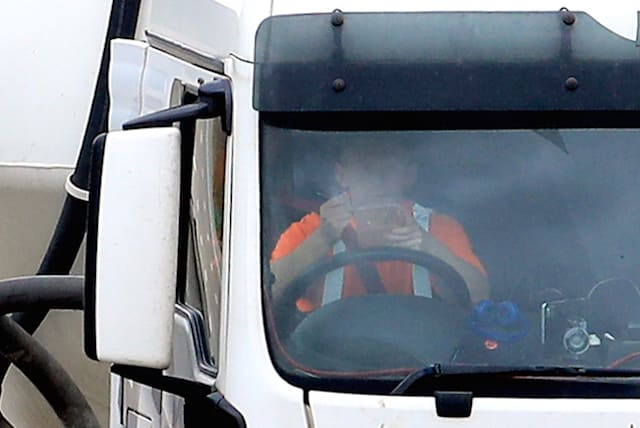 Lorry drivers shamed as photos show them eating, reading and on their phones