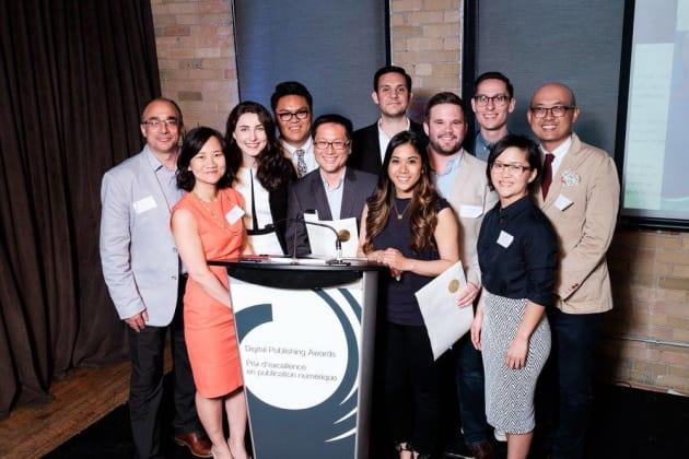 Kenny Yum, centre, and members of the HuffPost Canada team at the Digital Publishing Awards in Toronto...