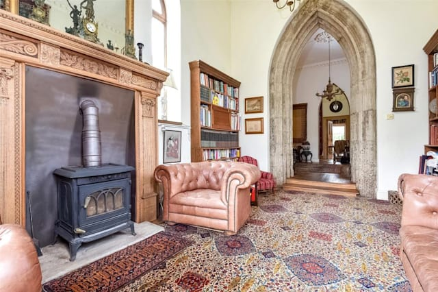 A lovely fireplace in one of the reception rooms