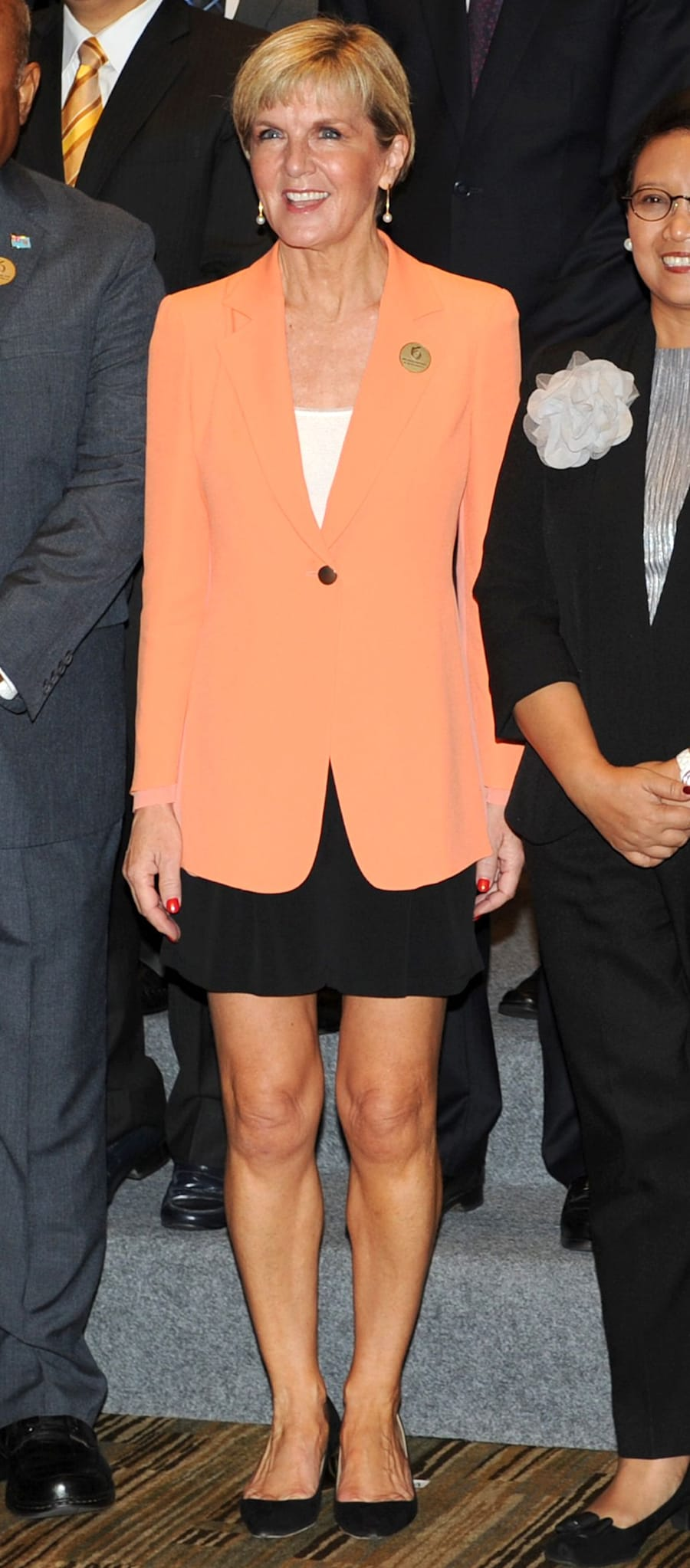 Want to stand out in a sea of white, black and grey? Invest in an orange blazer.