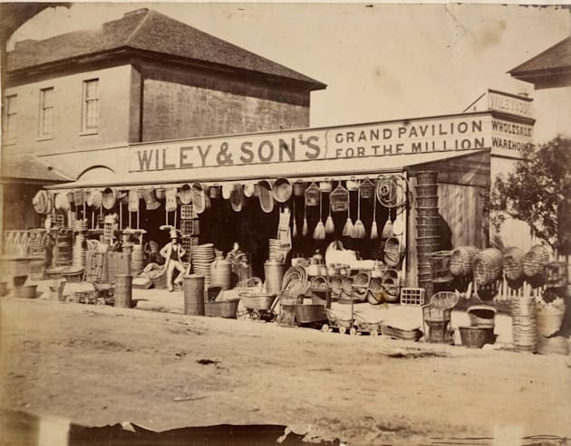 This photo is from 1858 and shows Wiley and Sons, on the corner of Pitt and Park Streets, Sydney. It...
